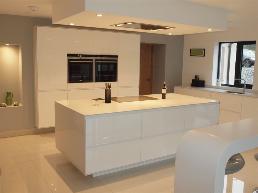 ATLANTIS KITCHENS PROJECT | Cartmel | Handleless Gloss White Kitchen   Slim  Silestone Worktops   Silestone Wrapped Around Units   Siemens Appliances ...