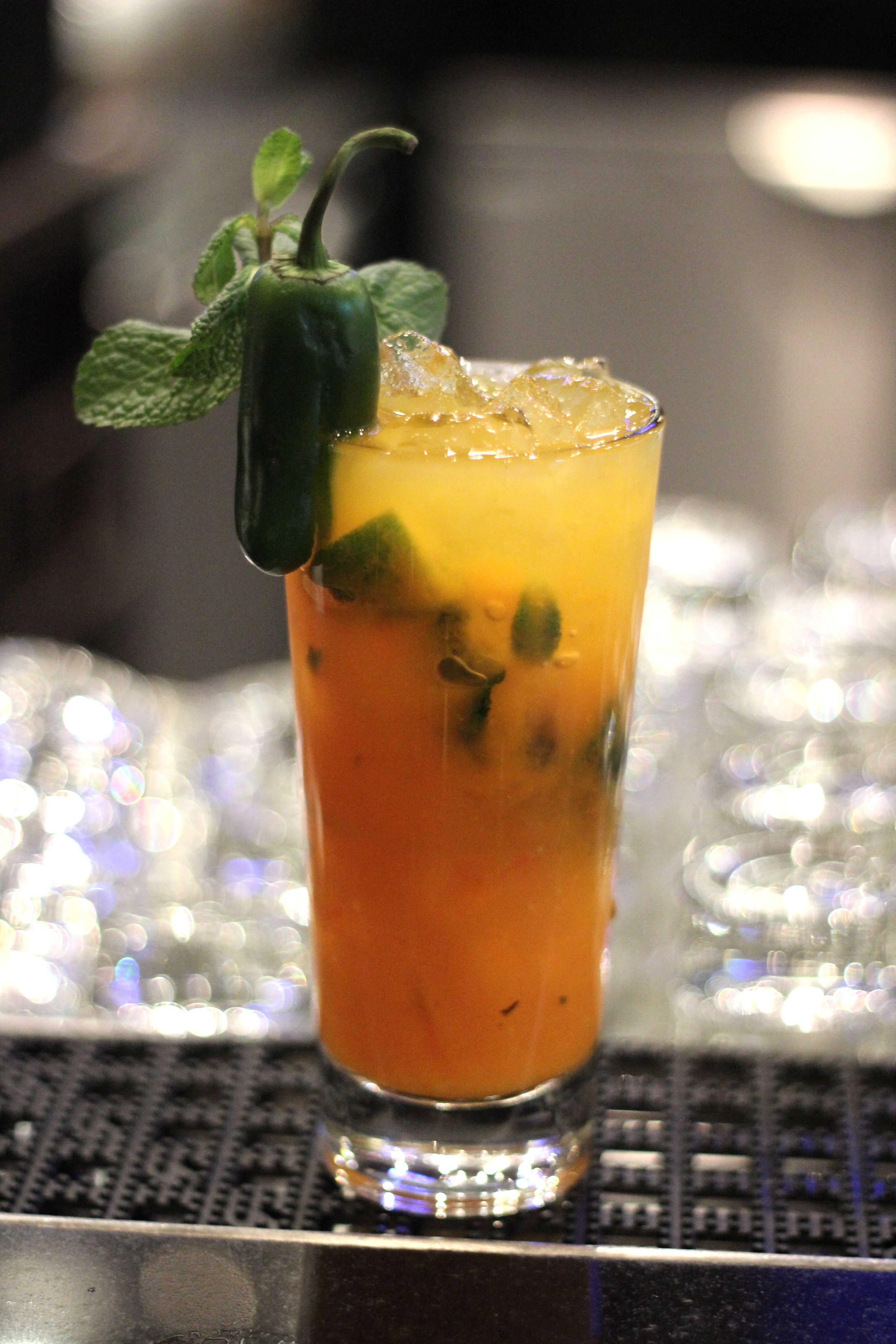 A Sassy Sidekick To Any Legendary Burger Our Spicy Mango Mojito Made With Mint Leaves Cubed Limes Sliced Jalapenos Sugar Syrup Mixed With Mango Purree