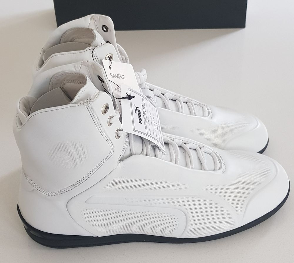 a3f54053c4f The high-top sneakers feature a premium leather upper in black or vaporous  grey (