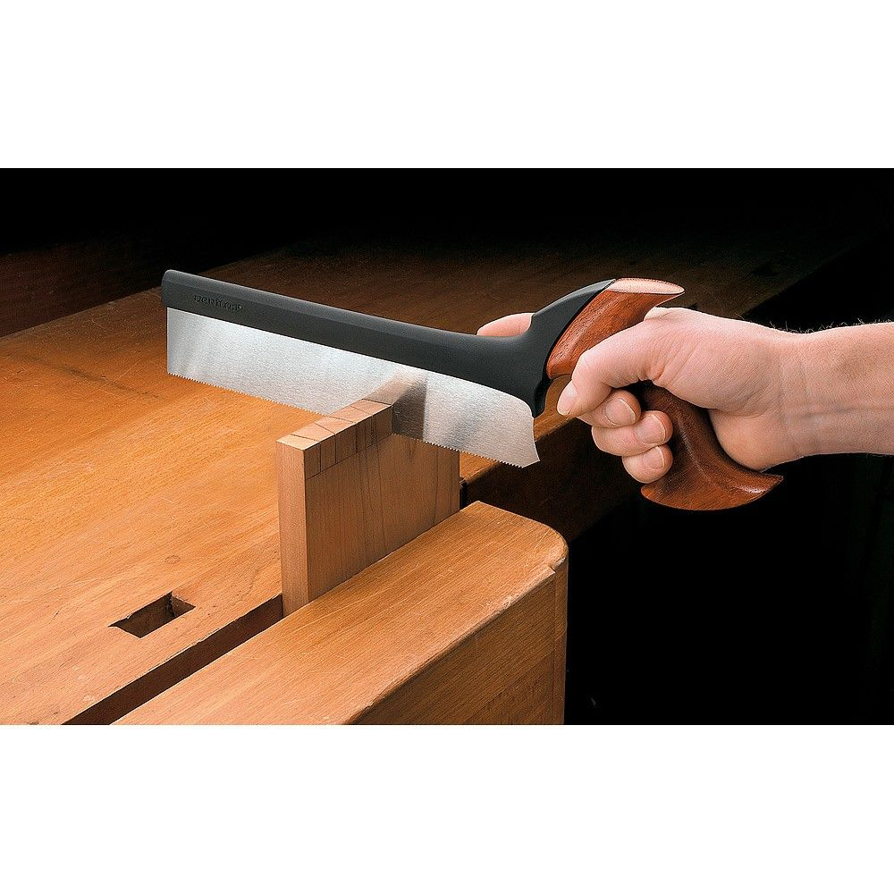 veritas dovetail £37  The saw's spine is permanently moulded onto the back of the blade. It imparts just the right amount of weight to the blade to carry the saw effortlessly into the cut. The polished hardwood handle is shaped to fit the hand comfortably and not just to look