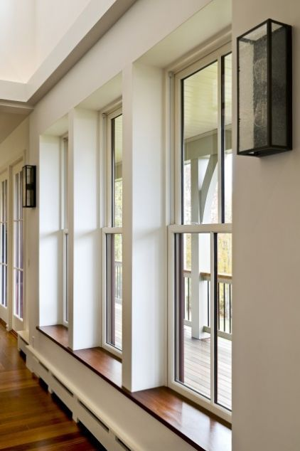 deeply recessed windows to give sills; contemporary dining ...
