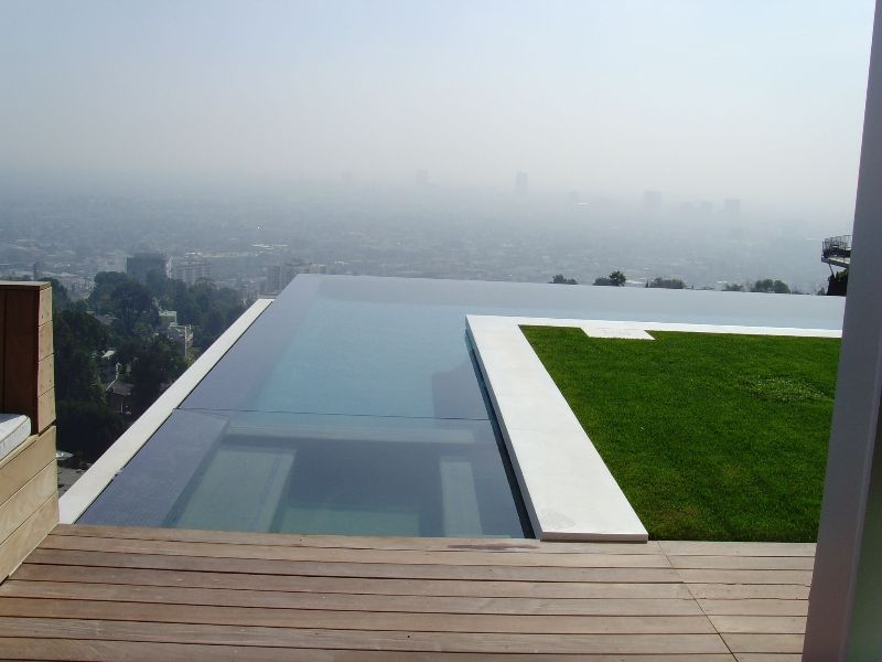 perimeter overflow pools look similar to a mirror lying on the ground check out