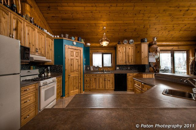 Log cabin kitchen - country living, Tucked away inside an ohio log cabin, this rustic open kitchen transports its owners to an adirondack state of mind. Description from hometiful.com. I searched for this on bing.com/images