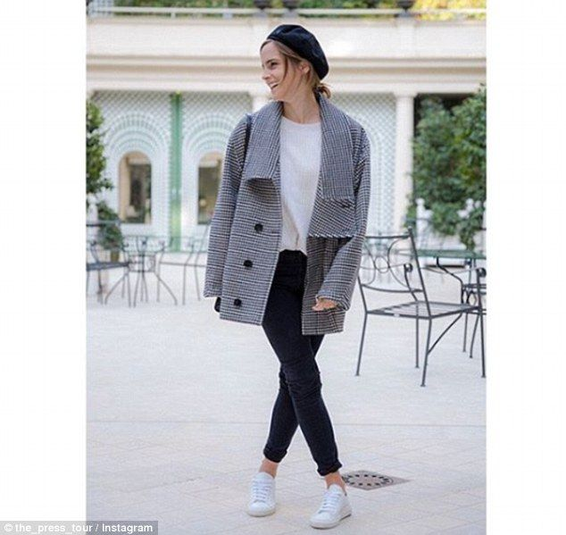 Stylish star: Emma donned a cozy sweater by Flippa K while in promoting the film in Paris