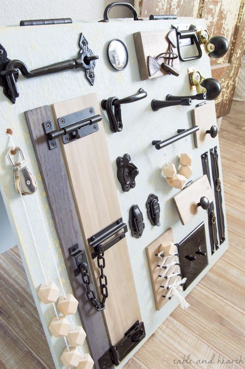 Photo of A Stylish and Rustic Busy Board for Baby | Table and Hearth