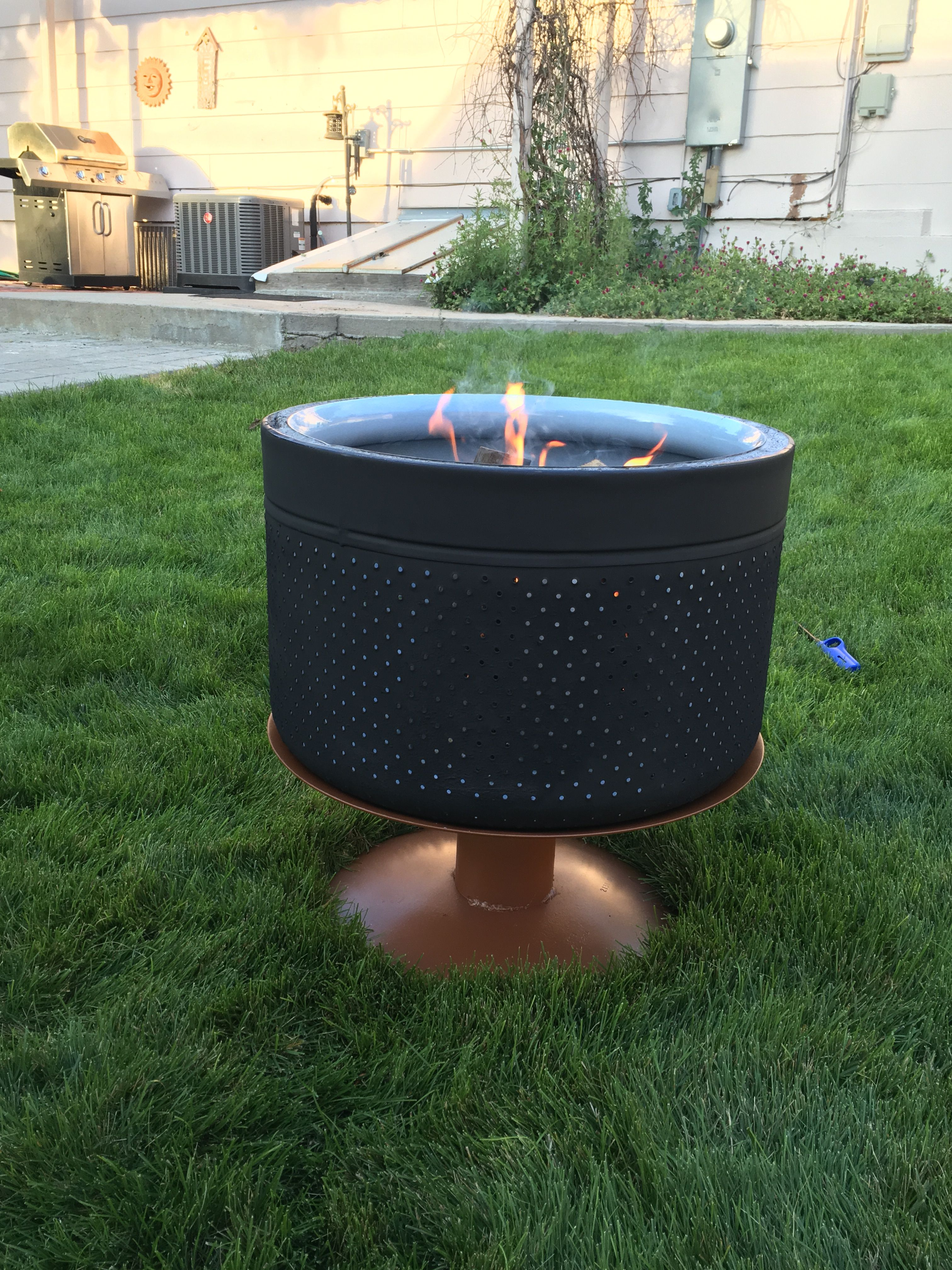 fire pit made from an old washing machine drum and two plow discs
