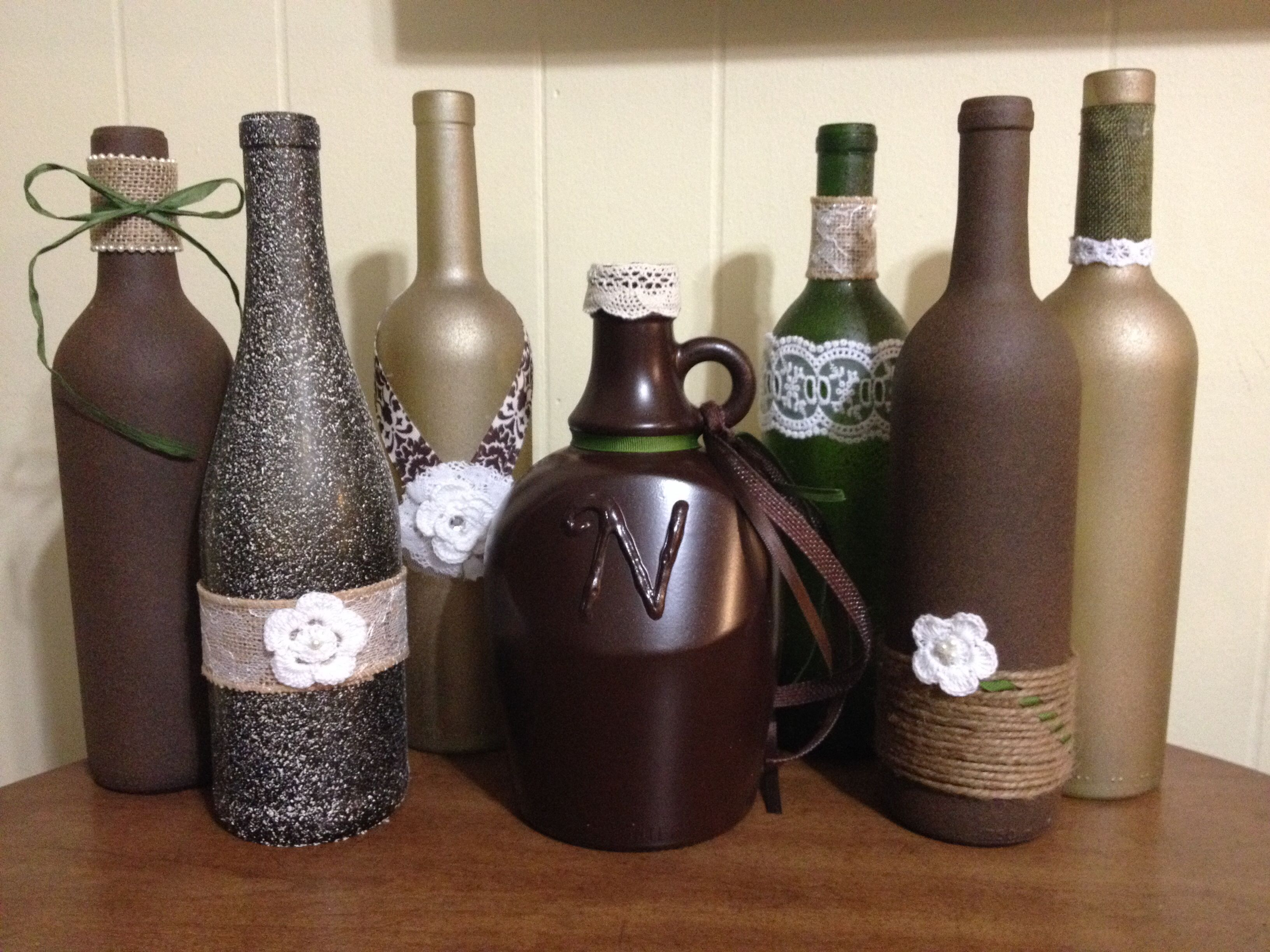 DIY repurposed wine bottles Centerpieces for rustic wedding or