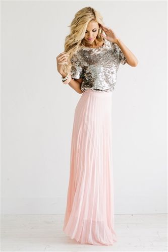 a447d13a00c This new maxi skirt has forced us to pic our jaws up off the floor. Pale  Pink maxi features tiny pleats