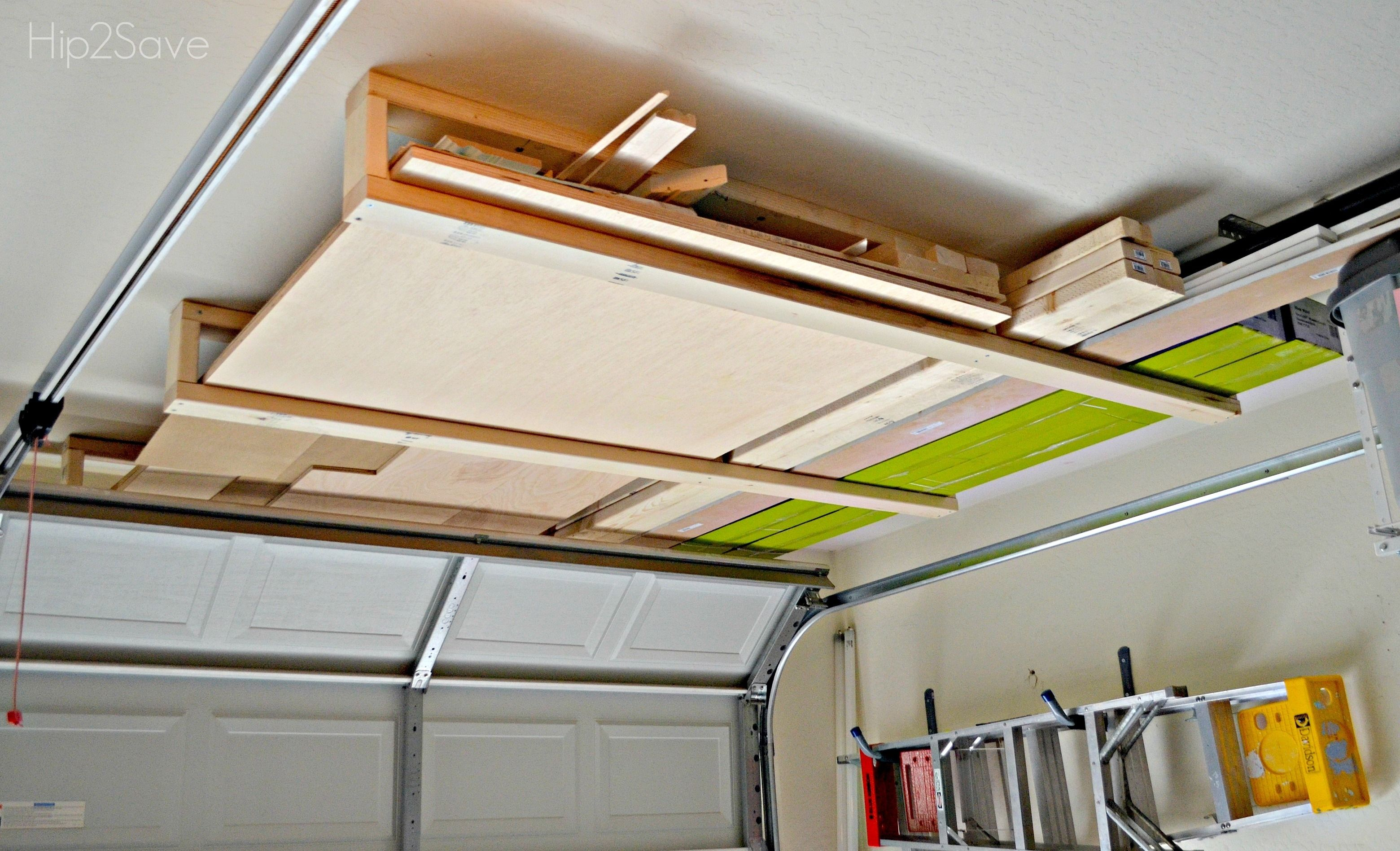 Above Garage Door Lumber Storage Lumber Storage Rack Lumber Storage Garage Ceiling Storage
