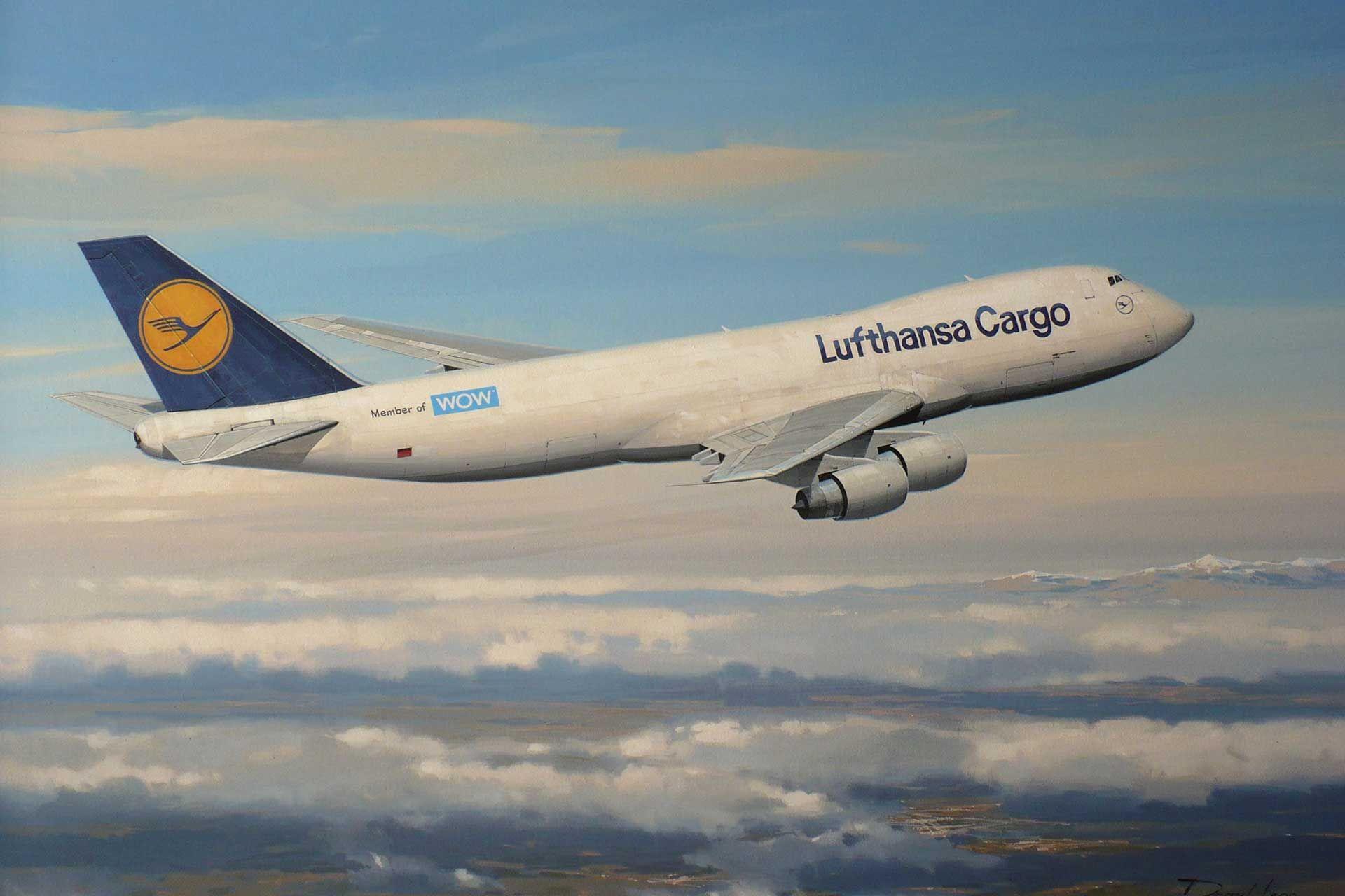 Boeing 747-230F A cargo laden Lufthansa Boeing 747 freighter climbs through the broken cloud en route to France.