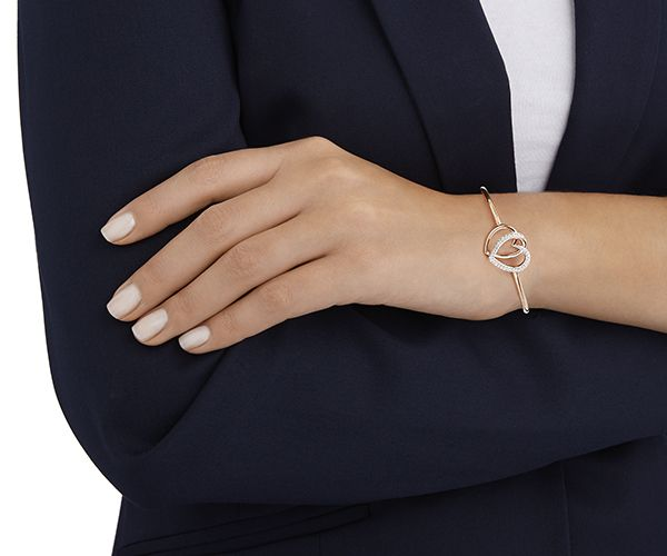 A sleek entwined heart design, a symbol of everlasting love – perfect for Valentine's Day. The Dear Bangle sparkles with refined clear crystal pavé... Shop now