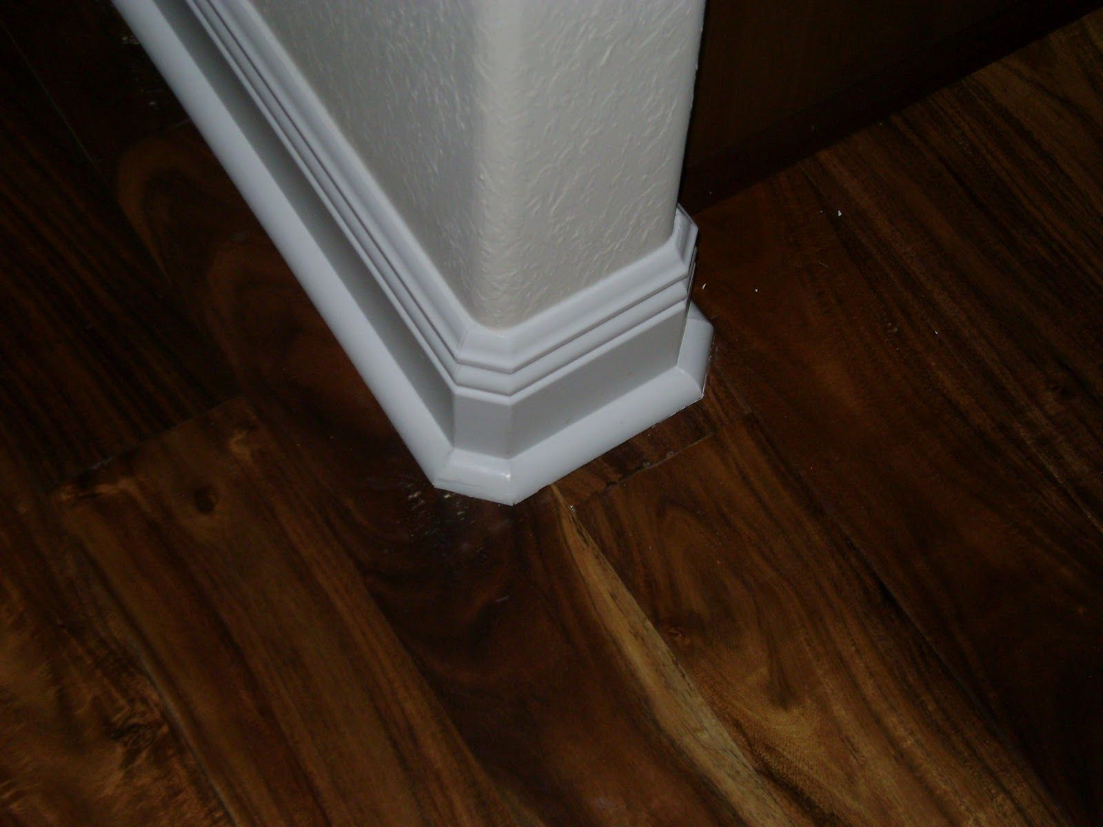 Floor trim with quarter-round.
