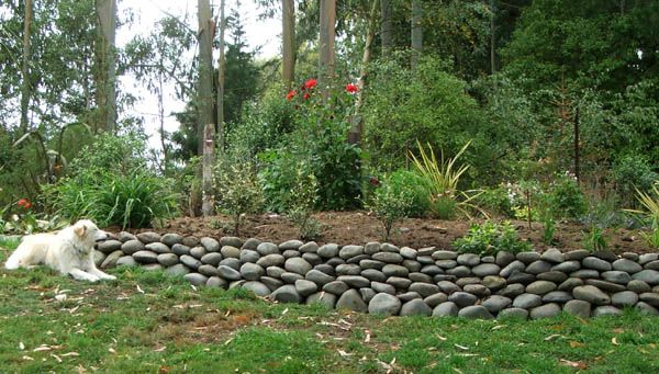 homes with mexican rock wall fence   The new stone wall, admired by ...
