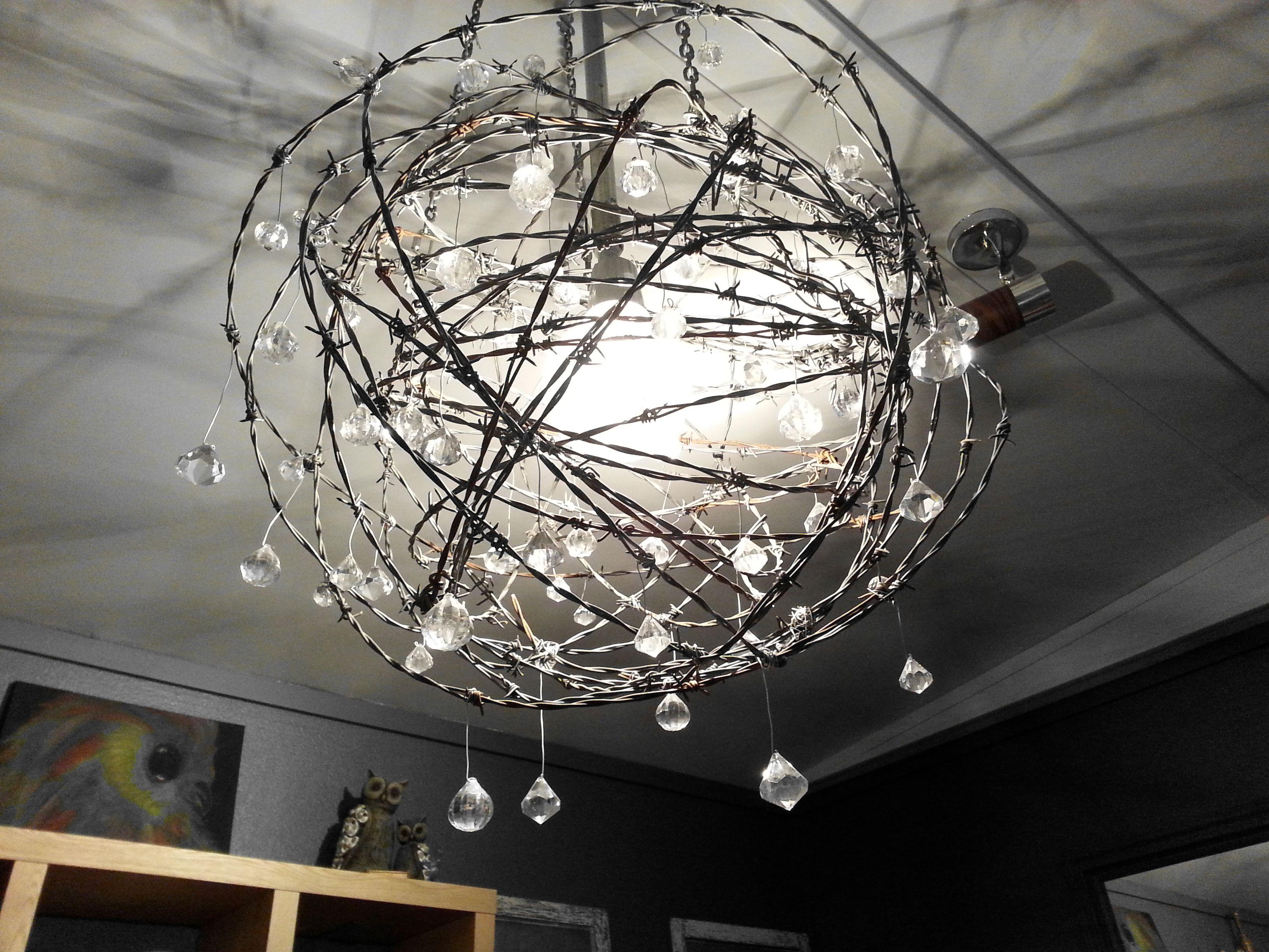 Beautiful handmade chandelier made with repurposed barbed wire beautiful handmade chandelier made with repurposed barbed wire arubaitofo Image collections