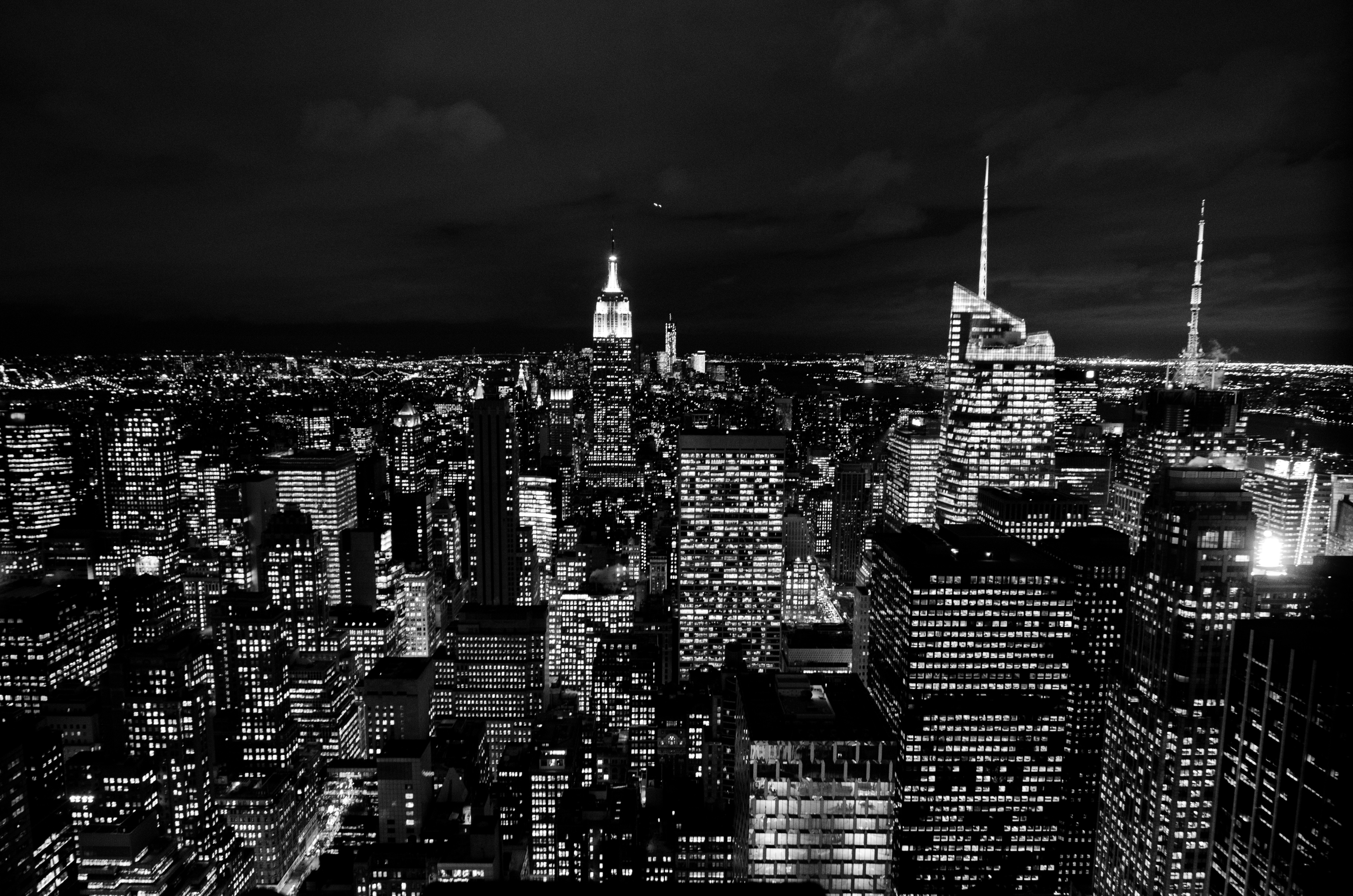 Black and white photo of the new york city skyscraper lights at night blanc images