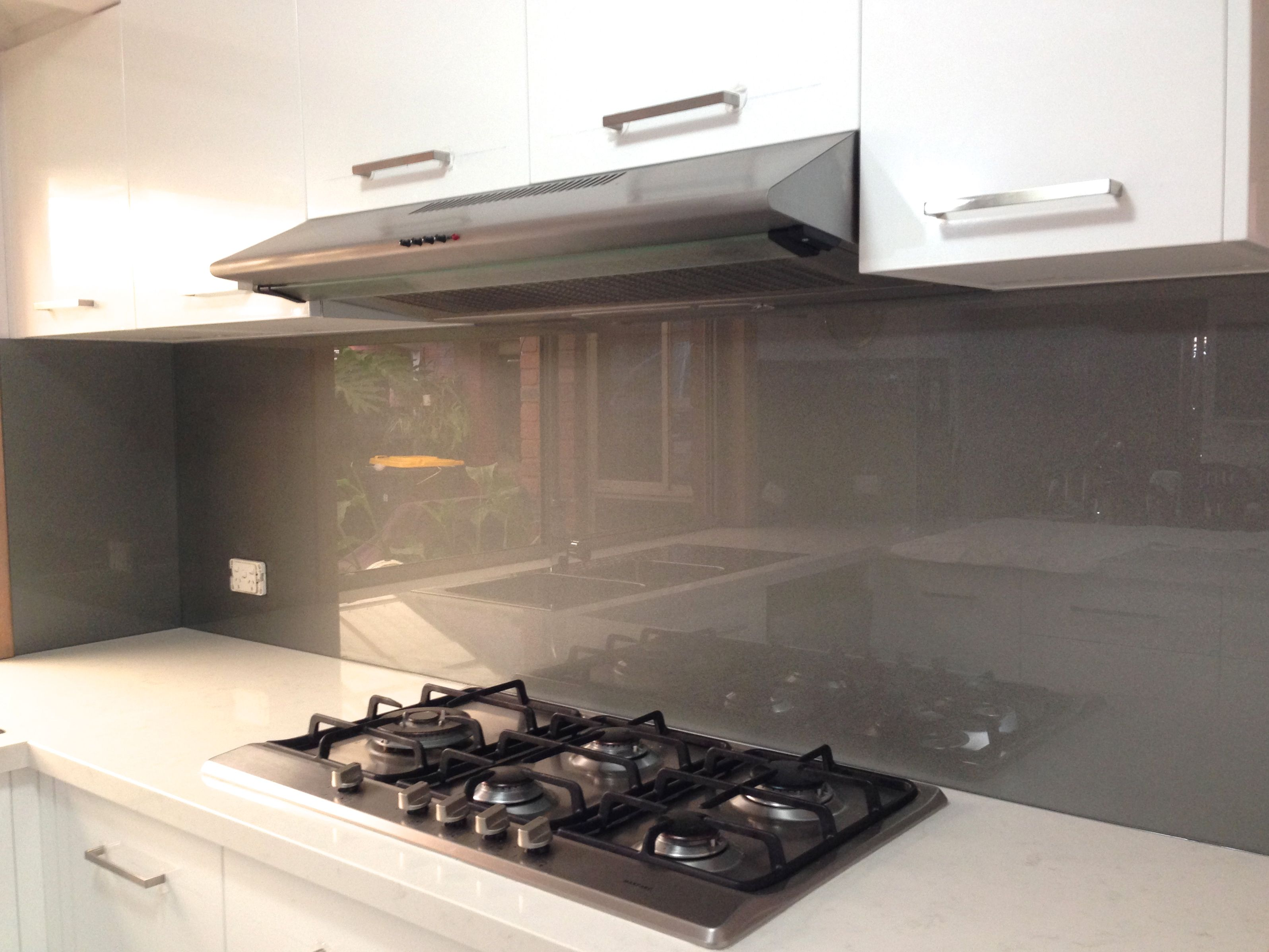 Metallic charcoal coloured glass splashbacks from ultimate Splashback tiles kitchen ideas
