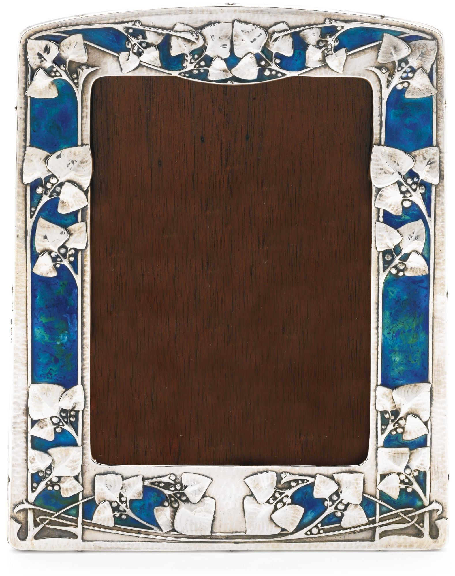 An Art Nouveau Silver And Enamel Frame Archibald Knox For