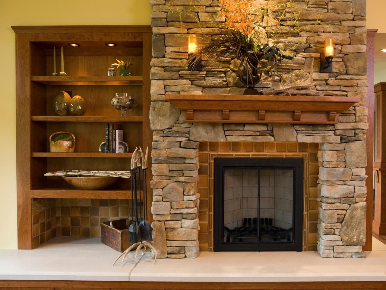 This rustic sandstone fireplace is trimmed with an elegant - Ideas to cover fireplace opening ...