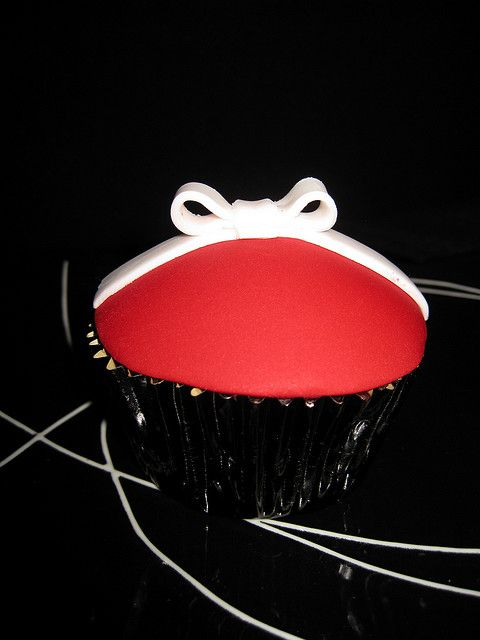 Chocolate Mud cupcake with ganache and fondant. Bow made from fondant     Looking for great handmade products for gifts or personal collectibles.  Visit www.Pandhara.com