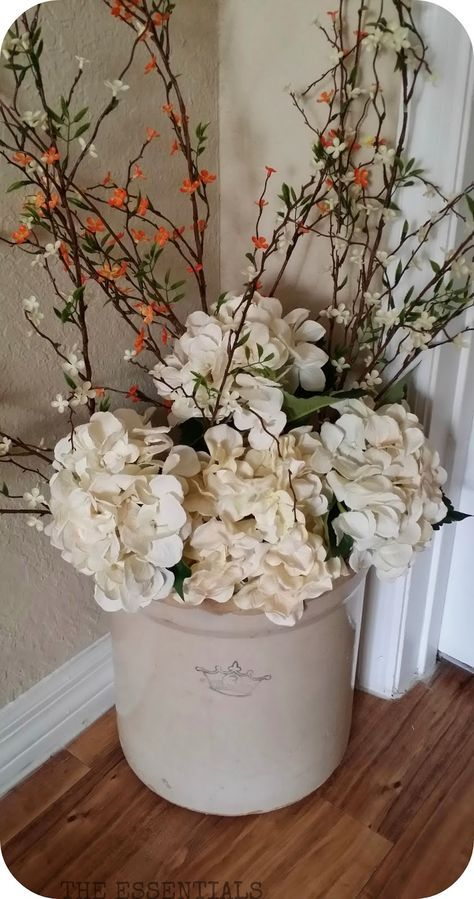 Dress up and old crock with flowers for the season