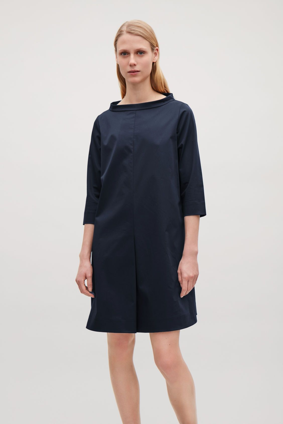 b243bbf3041 Model side image of Cos cotton dress with stand-up collar in blue ...