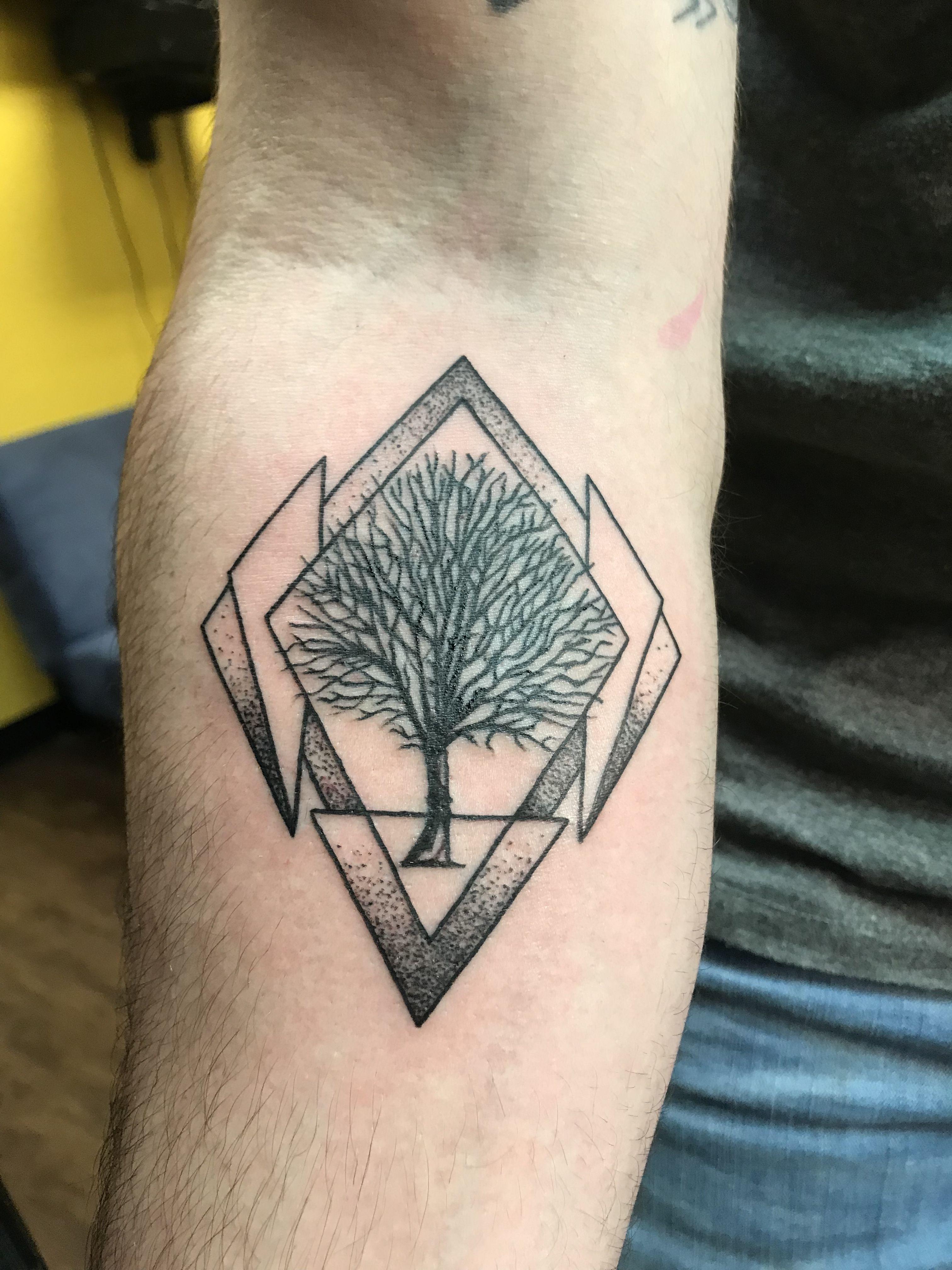 Tree geometric tattoo men forearm medium black tattoo