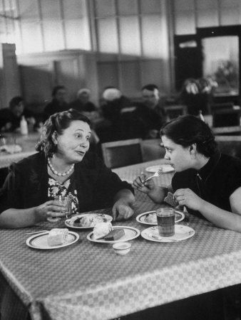 Woman and Her Daughter Eating in a Restaurant  by Lisa Larsen