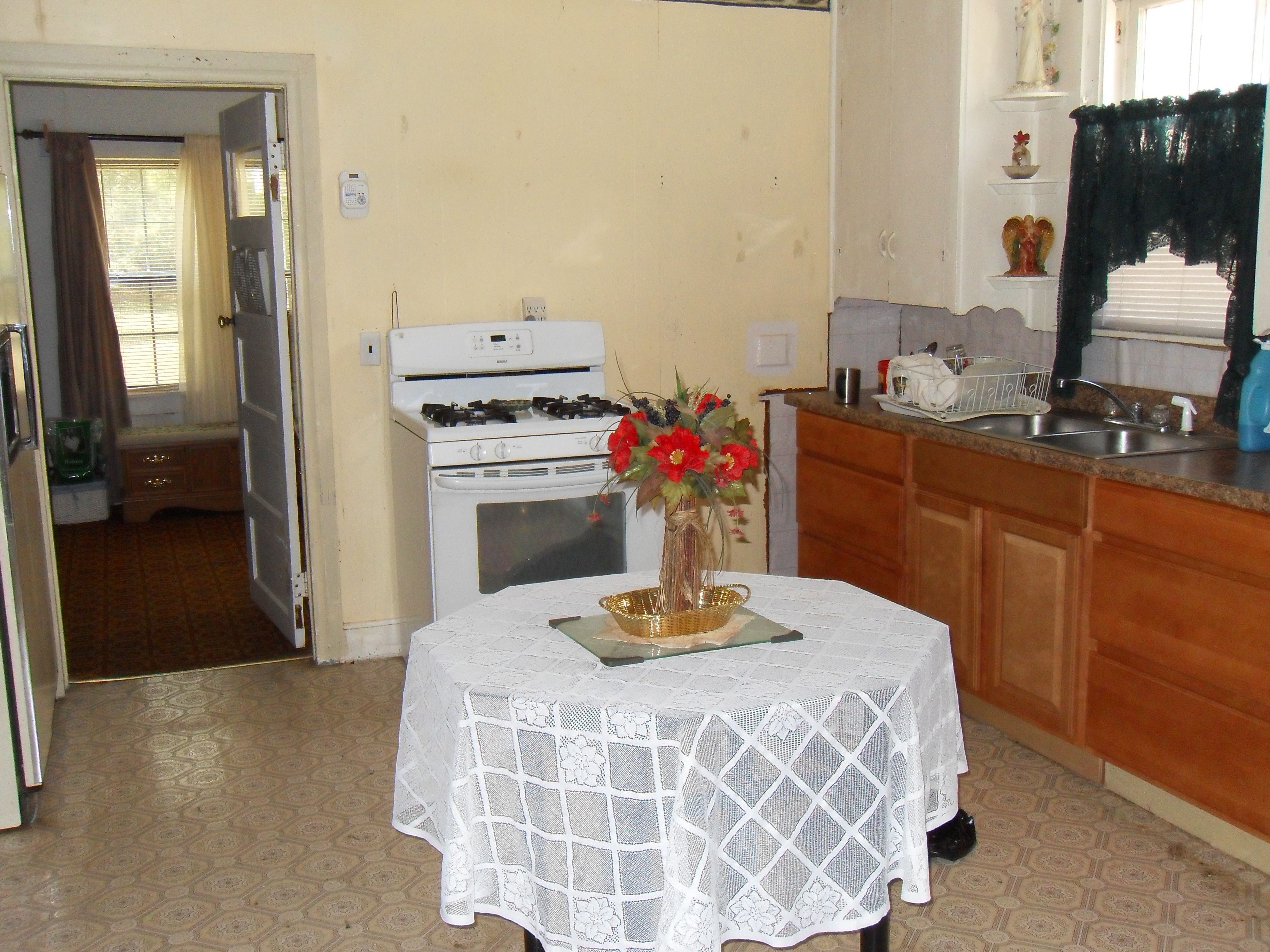 large spacious kitchen with new lower cabinets , counter and sink.  ( appliances are not included)