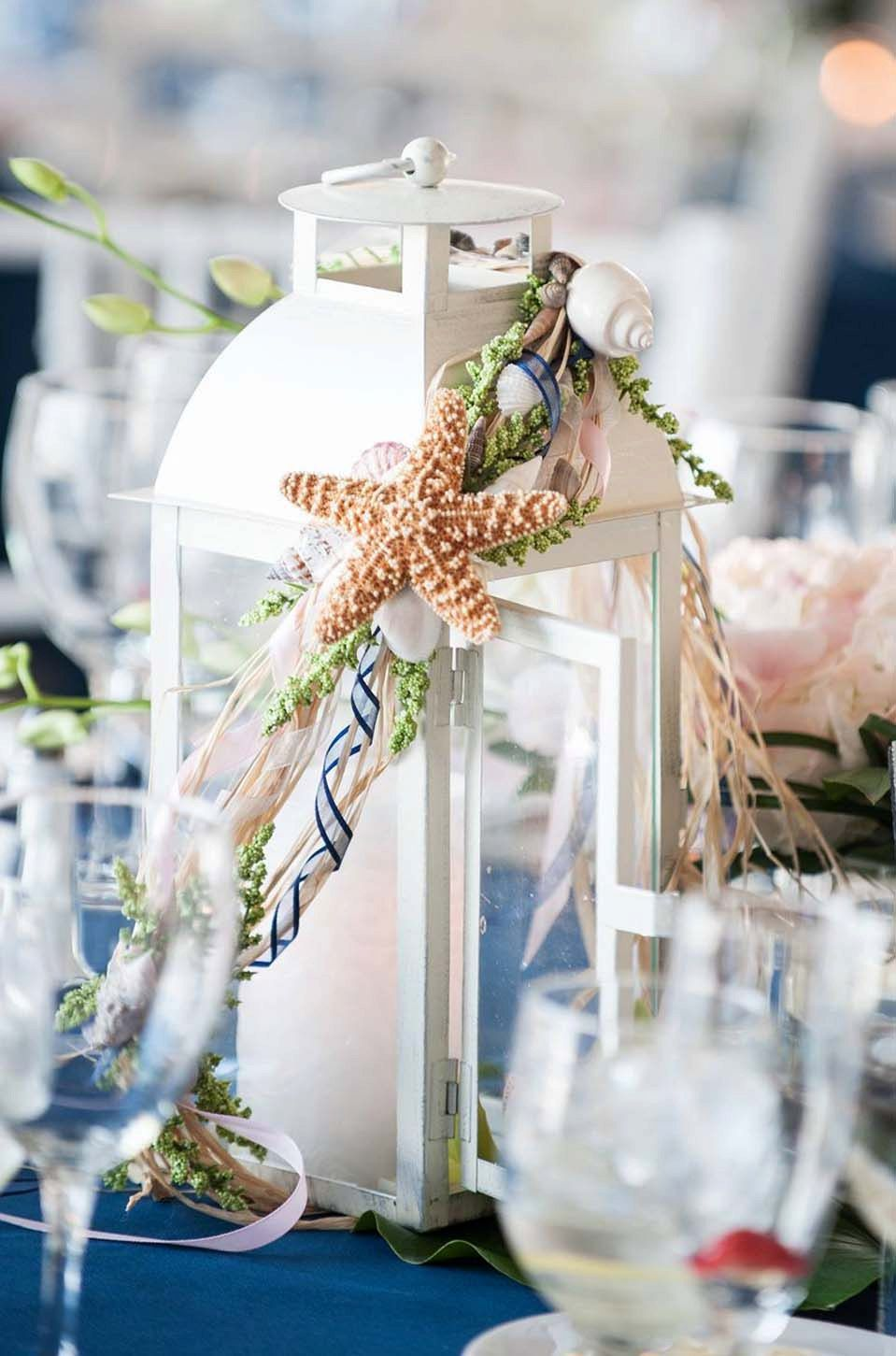 Distressed beach themed wedding lanterns centerpieces by