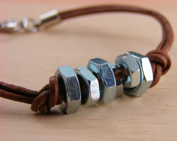 Leather Hardware Bracelet. If you are even slightly crafty, make it yourself. Don't use nuts with sharper points, it will dig into your skin.