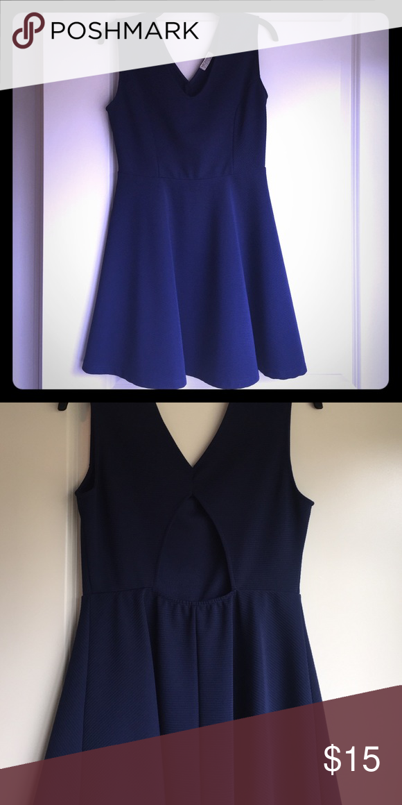 Navy blue A-line dress with cut out in back This dress is tight at the top and flares out at the waist. It is navy blue and has a triangular cut out in the back. Bought at a boutique in New York City Dresses Mini