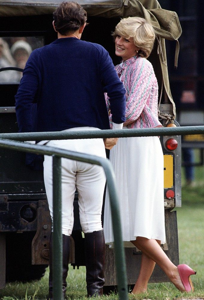 We're loving the pops of pink in Diana's outfit, here while watching Charles play Polo. via StyleList