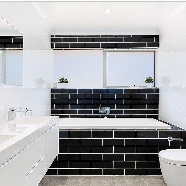 Black subway tiled walls square white inbuilt bathtub in wall cistern unit white floating vanity with dual bench top basins chrome tap and mixer Project by  mattbuildptyl...