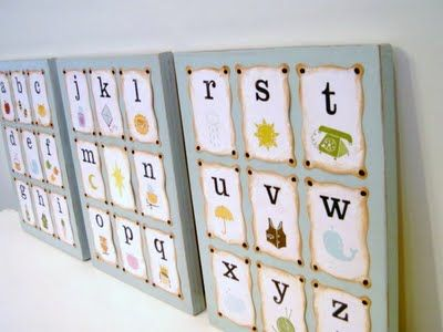 DIY alphabet artwork using three pieces of wood, alphabet cards, and some paint, brown ink pad, and brads. This is so cute!
