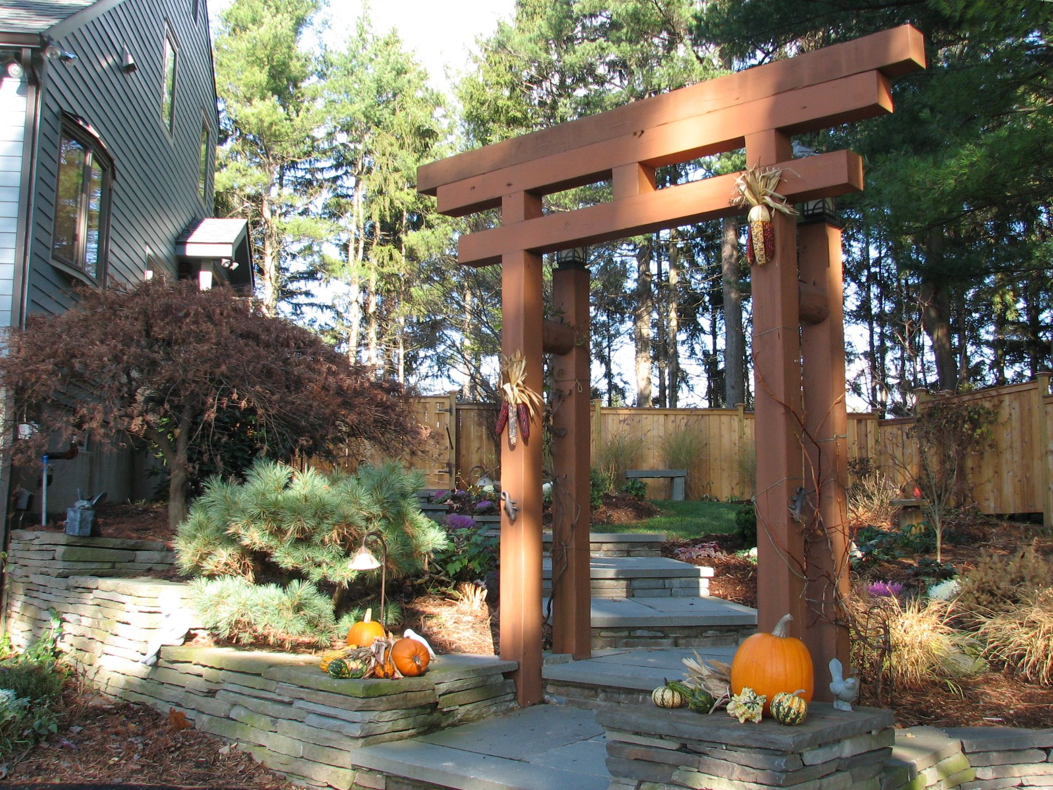 Japanese arbor idea blue stone walkway with japanese for Japanese garden trellis designs