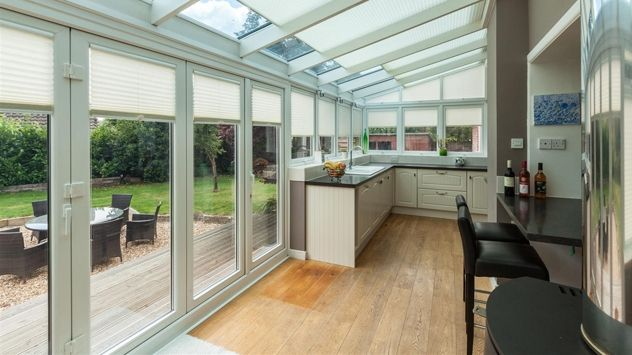 shaped pleated window blinds in a kitchen conservatory extension - Kitchen Conservatory