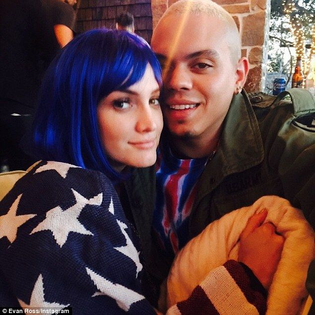 Yummy mummy: Pregnant Ashlee sported a blue wig and oversized stars-and-stripes sweater