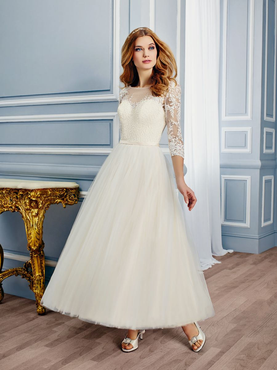 609ca47a2bd The sheer Bateau neckline is embellished with luxurious lace and continues  onto the sheer 3 4 sleeves. A couture band accentuates your natural waist  and ...