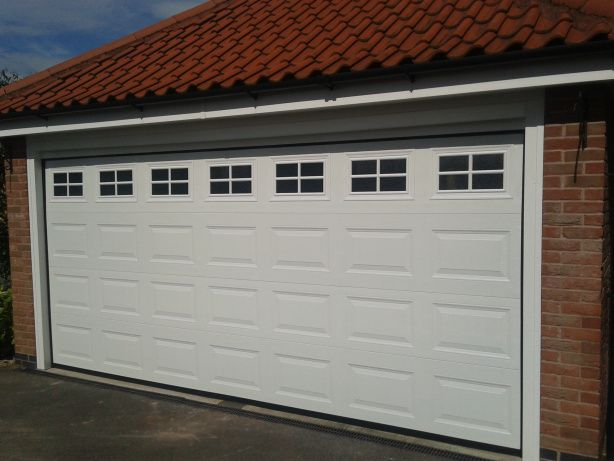 Why Garage Door Torsion Springs Malfunction Garage Doors Garage Door Torsion Spring Garage Door Design