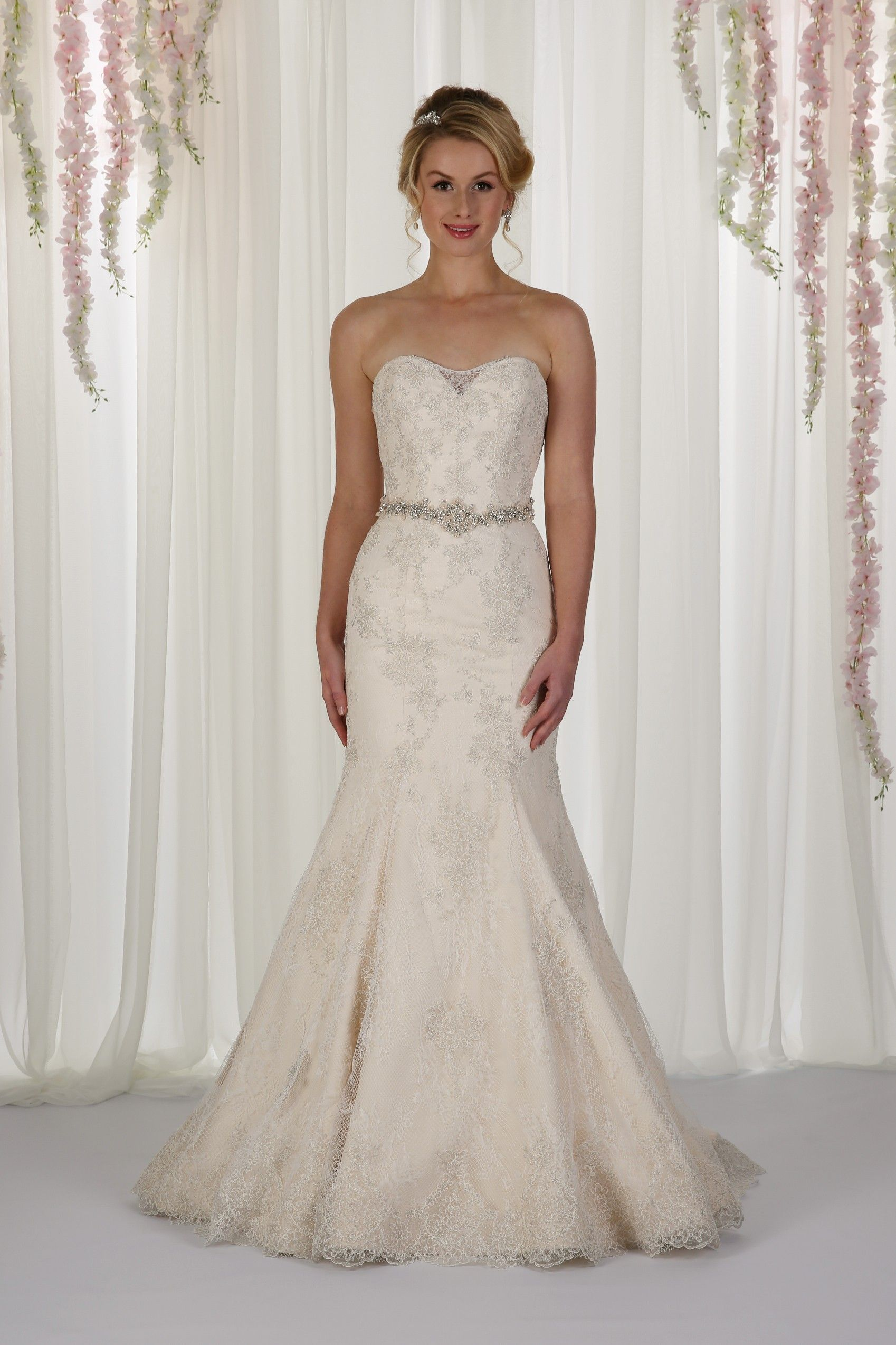 bbbca4bd2b121 Cherry is a flattering fishtail gown embroidered with lace and an  embellished waistline.