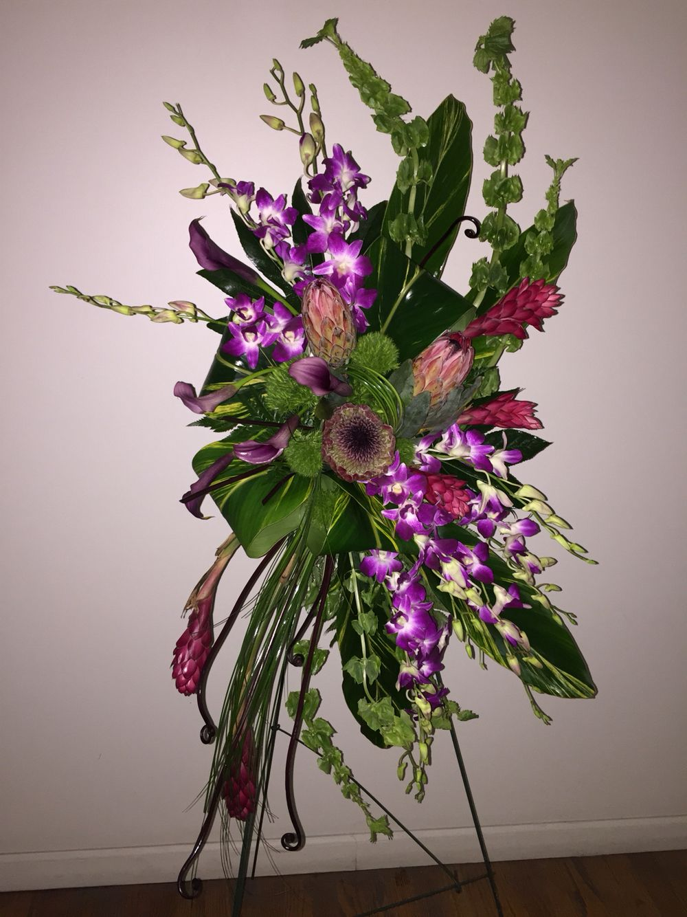 Modern Tropical Funeral Easel With Orchids Protea Bells Of