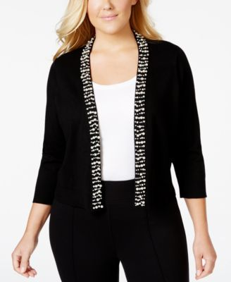 Pearly beads add undeniable elegance to this plus size knit shrug from Calvin Klein, the perfect cropped topper for your dressy wardrobe! | Rayon/nylon | Machine washable | Imported | Collarless | Ope