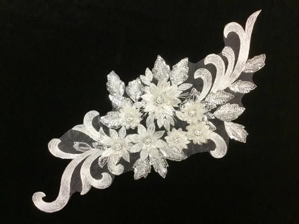 White appliqué with sequins and rhinestones dance costumes