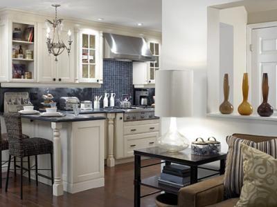 cream kitchen cabinets with blue glass tile backsplash! ivory
