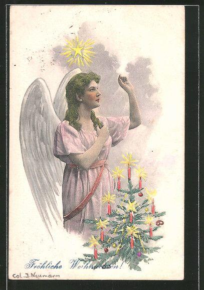 cartolina antiche: AK Weihnachtsengel steht am Weihnachtsbaum