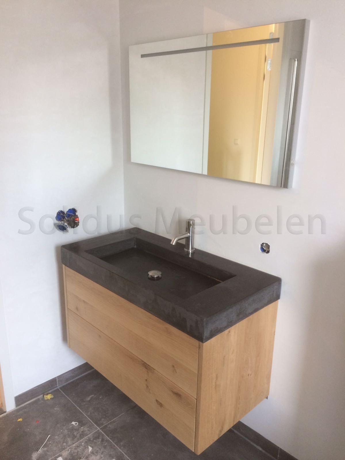 eikenhouten lades met betonnen wastafel badkamermeubel van hout