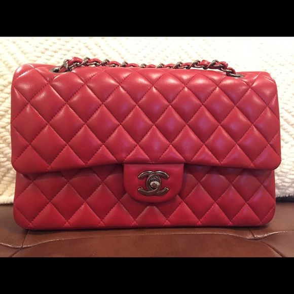"""Red Chanel medium flap bag Chanel medium bag has only been used a handful of times.  There are absolutely NO rubs, scratches, tears, creases or indentations to the exterior leather at all. All of the quilts are puffy, and there is no loss of shape.   excellent condition. The interior compartment is in excellent/clean condition. Approximate Measurements:  10"""" W, 6"""" H 2.50"""" D  Made of lambskin.  color is the classical red  Hardware is a darker Silver. serial number of the bag is 20648757 paid…"""
