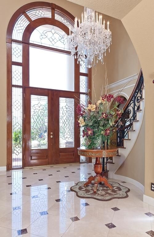 Problem Stairway Facing Front Door Solution Hang A Round Faceted Crystal Ball Half Way Between The Bottom Of The Stairs Wall Colors Round Desk Entry Stairs