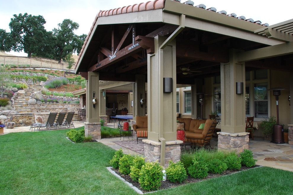 Backyard Patios Ideas Patio Mediterranean with Column ... on Cost Of Backyard Remodel id=49262