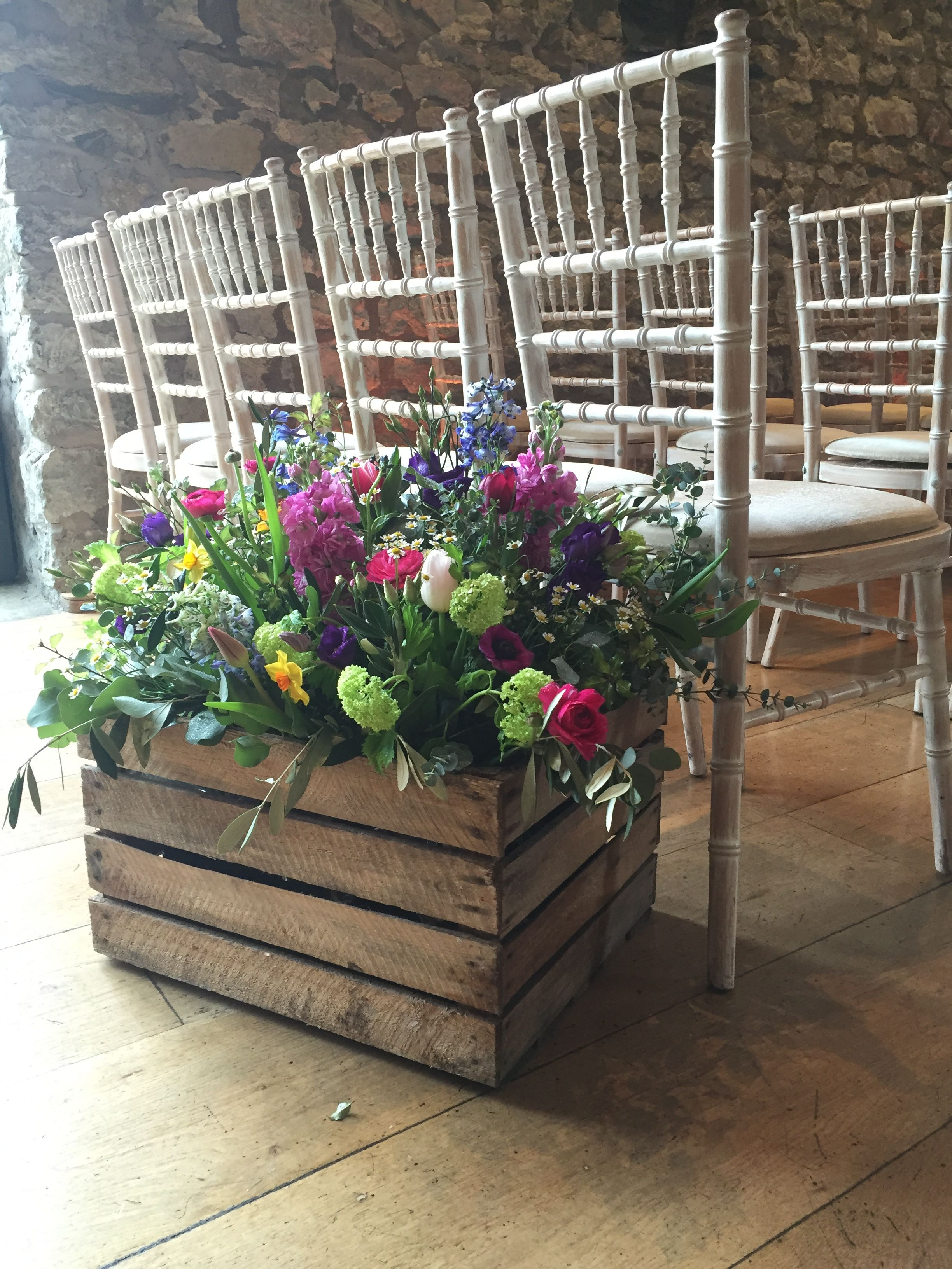 Summer flowers at the foot of the aisle   Wedding venues ...